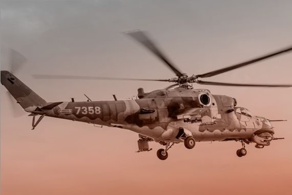 military helicopter flying in sky
