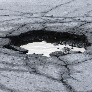 hole on road with puddle